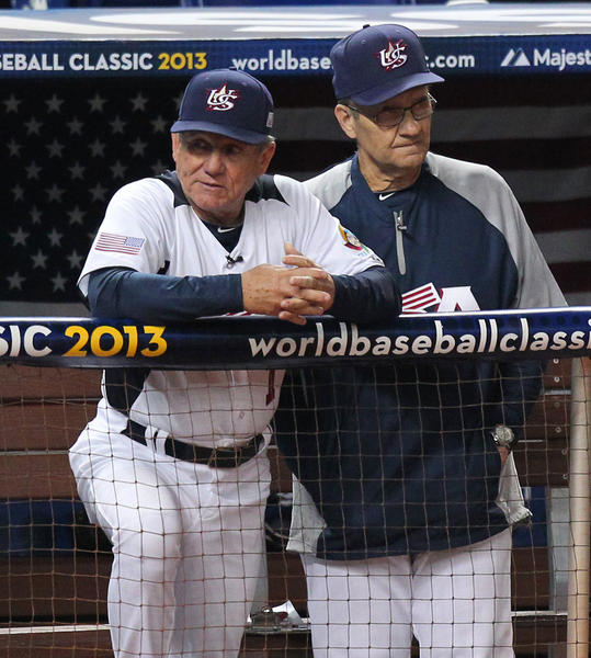 United States bench coach Larry Bowa and manager Joe Torre watch from the dugout during the fourth inning against Puerto Rico.