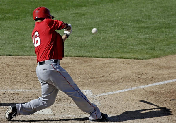 Angels catcher Hank Conger hits a two-run single during the sixth inning of an exhibition game against the Milwaukee Brewers.