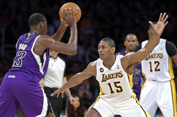 Lakers forward Metta World Peace plays tight defense on Kings point guard Tyreke Evans in the first half Sunday night at Staples Center.