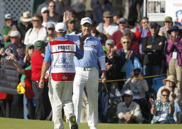 David Frost high-fives his caddie after he sank a birdie putt on 17th hole en route to winning the 2013 Toshiba Classic at Newport Beach Country Club.
