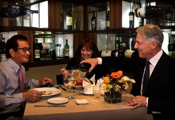 Owner Piero Selvaggio pours wine for patrons at Valentino restaurant in Santa Monica on March 06, 2013. Valentino is celebrating its 40th anniversary and is a landmark of fine dining in Southern California.