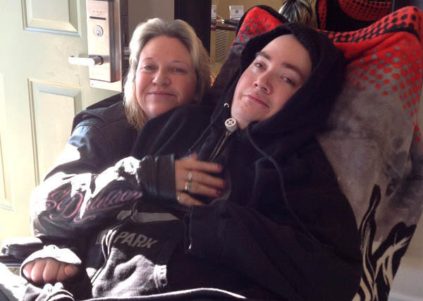 Brandon Maxfield with his mother, Sue Stansberry, in January. He was badly injured when shot with a gun made by Bryco Arms.