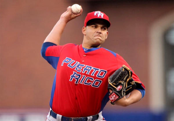Puerto Rico's Mario Santiago (53) pitches against Japan during the first inning.