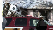 Two people were killed and three people hospitalized when a small plane crashed into three homes in South Bend, Ind., Sunday afternoon.
