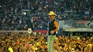 "Kenny Chesney's No Shoes Nation Tour started its trek across America in Tampa, Florida this weekend. On Saturday (3/16), 48,000 fans helped Kenny kick things off at Raymond James Stadium and tailgaters arrived seven hours early to get the party started. The ""Pirate Flag"" singer tapped ESPN analyst Jon Gruden to give his band and crew a pep talk before the big night. The Eli Young Band, Eric Church and Kacey Musgraves opened the show, which culminated in a more than two-hour set from Kenny. (26 songs)"