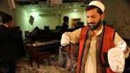PESHAWAR, Pakistan— A suicide bomber killed four other people and injured at least 33 after rushing into a crowded courtroom in the northwest Pakistan city of Peshawar on Monday and detonating his explosives, police and witnesses said.