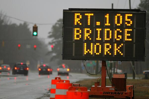 As this sign on Jefferson Avenue indicates, bridge work on Route 105 at Fort Eustis was supposed to have begun today, but the work has been delayed.