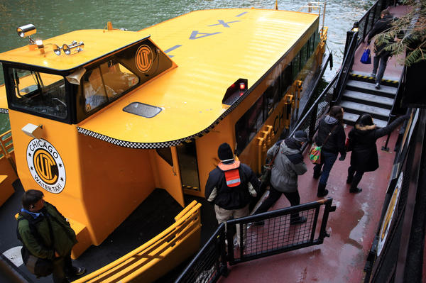 Chicago Water Taxi passengers disembark at the Lasalle/Clark stop early today as weekday service resumes.