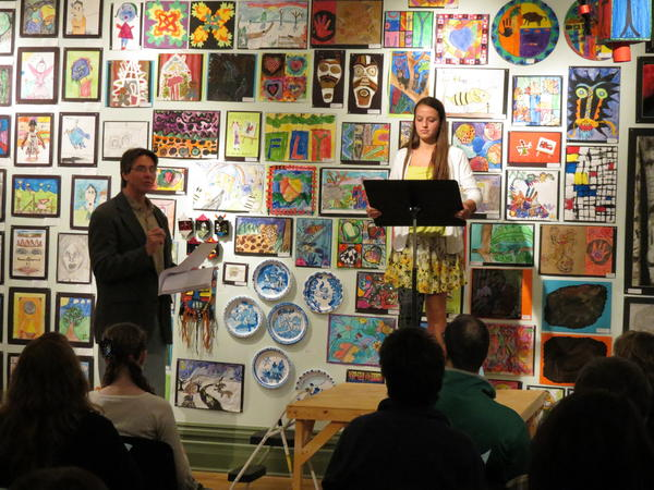 Sadie Cwikiel of Harbor Springs is introduced by Thomas Renkes (left) at the 2012 Young Writers Expo at Crooked Tree Arts Center. Sadie read her winning prose work.