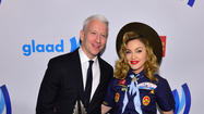 "For the GLAAD Media Awards on Saturday night, Madonna put together an outfit reminiscent of a Boy Scout: navy shirt with badges, shorts, neckerchief, hat. And fingerless gloves. ""I wanted to be a Boy Scout and they wouldn't let me,"" she said. The event honored newscaster Anderson Cooper. <a href=""http://nymag.com/thecut/2013/03/madonna-went-as-a-boy-scout-to-the-glaad-awards.html"">[The Cut]</a>"