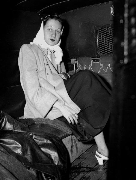 Ruth Steinhagen is taken away in a police paddy wagon after shooting Phillies first baseman Eddie Waitkus in 1949. Steinhagen, 19, had developed an obsession for Waitkus. She checked into the Edgewater Beach Hotel in Chicago and had a note sent to Waitkus' room saying she had to see him. When he arrived at her 12th-floor room, she shot him in the chest, just below the heart. He eventually recovered and played for six more seasons. Steinhagen was declared insane and committed to Kankakee State Hospital in Illinois. In 1952, she was judged sane and freed.