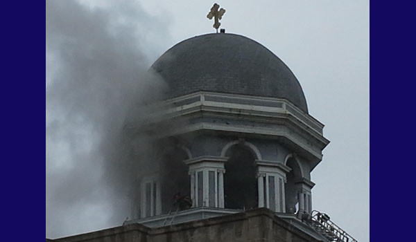 Firefighters on the roof of St. Basil Greek Orthodox Church.