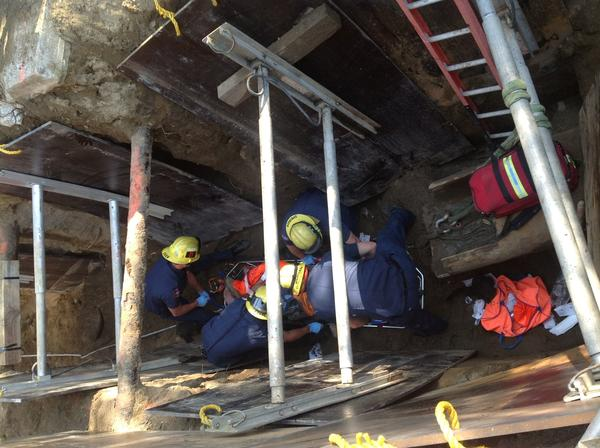 Burbank firefighters rescue the man, 50, after he fell into the trench on Friday.
