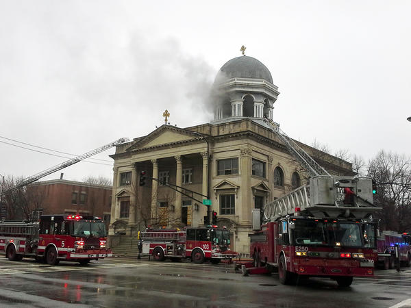 Smoke pours from the dome of St. Basil Greek Orthodox Church.