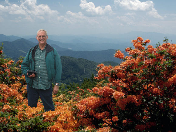 Don Hyatt with Flame azaleas blooming in the mountains.