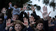 ATHENS — Amid renewed fears of a widening economic crisis in Europe, Cyprus on Monday ordered its banks shut through Thursday, postponing for a second time in two days a crucial parliamentary debate on whether bank depositors on the Mediterranean island should pay a levy of up to 10% in exchange for a $13-billion international bailout.