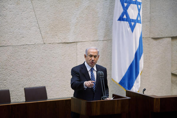Israeli Prime Minister Benjamin Netanyahu speaks to members of the Knesset on Monday, when Israel's 33rd government was sworn in after almost six weeks of negotiations to piece together a coalition.