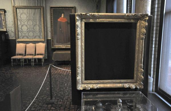 "Empty frames from which thieves took ""Storm on the Sea of Galilee,"" left background, by Rembrandt, and ""The Concert,"" right foreground, by Vermeer, remain on display at the Isabella Stewart Gardner Museum in Boston."
