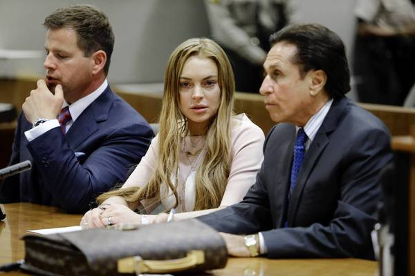Lindsay Lohan and attorneys Mark Heller, right, and Anthony Falangetti appear at a hearing in Los Angeles County Superior Court on Monday.