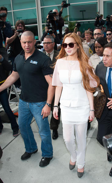 Lindsay Lohan wears a white outfit by 3.1 Phillip Lim as she leaves court in Los Angeles.