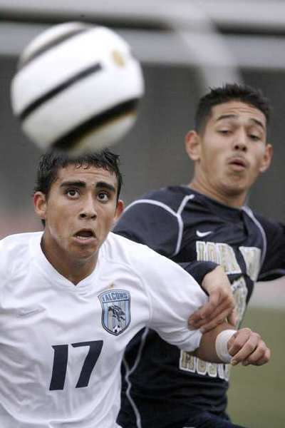 Crescenta Valley High School's #17 Pablo Sotillo keeps his eye on the ball during home game vs. Muir High School in La Crescenta on Friday, January 25, 2013. The game ended in a tie, 1-1.