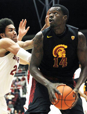 Dewayne Dedmon, right, was suspended indefinitely from the USC men's basketball team.