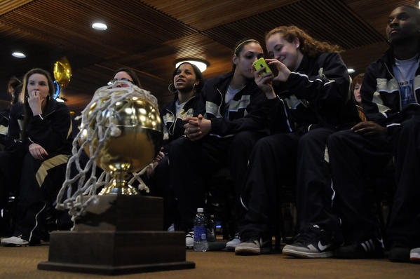 The Quinnipiac women's basketball team, which earned its first NCAA Tournament berth, waits for the selection show on ESPN to start to see who the Bobcats will face and where. They were named a No. 13 seed and will play No. 4 Maryland on Saturday in College Park, Md.