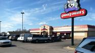 A three-year-old girl is in protective custody after police found her and two adults asleep in a car in the Chuck E. Cheese's parking lot Sunday afternoon.