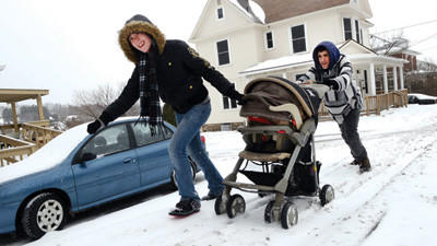Heather Roversi and Michael Irons had to put their push and pull together to keep the stroller holding Heather's daughter, Kyleish, moving in Somerset on Monday. The two were working their way home along East Main Street.
