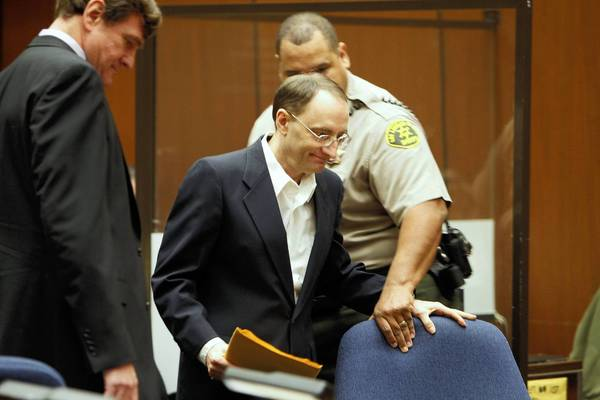 Christian K. Gerhartsreiter takes his seat before the opening statements in his murder trial in downtown Los Angeles. Gerhartsreiter is accused of bludgeoning John Sohus to death in San Marino in 1985.