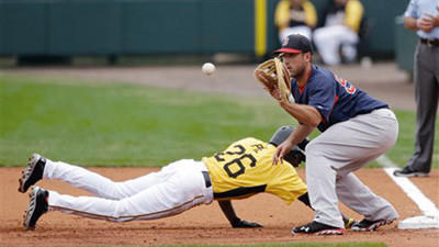 Pittsburgh Pirates' Felix Pie safely jumps back to first as Boston Red Sox first baseman Travis Shaw waits for the throw during the first inning of an exhibition spring training baseball game Monday in Bradenton, Fla.