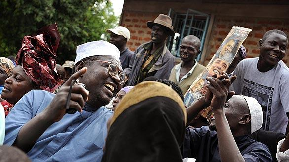 Malik Obama, half-brother of Barack Obama, sings in celebration with his family after the U.S. election results are announced in 2008. (Tony Karumba / AFP/Getty Images)