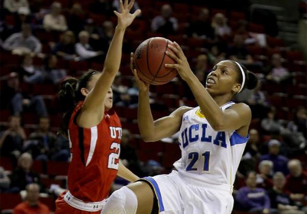 UCLA's Nirra Fields (21) puts up a shot against Utah's Danielle Rodriguez.