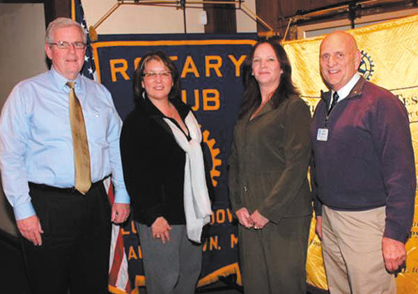 New members were inducted recently into Long Meadows Rotary by club officers. From left, Frank Morrisey, inductee; Donna Long, club treasurer; Dottie Gordon, inductee; and Ron Bowers, club president.