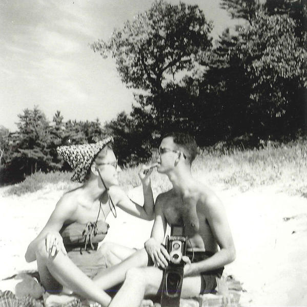 David Broder and Ann Collar Broder sit on a Beaver Island beach in an undated photo.