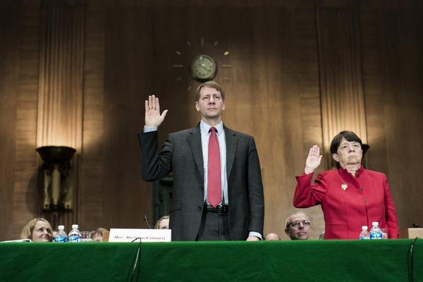 Richard Cordray, nominee for director of the Consumer Financial Protection Bureau, and Mary Jo White, nominee for chair of the Securities and Exchange Commission, are sworn in prior to testifying at a confirmation hearing before the Senate Committee on Banking, Housing and Urban Affairs last week.