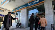 ATHENS -- Scrambling to stave off a chaotic government default and exit from Europe's single currency club, Cyprus' beleaguered government on Tuesday proposed a revised plan to shield small account holders from a divisive tax on bank accounts, hoping to dampen discontent and secure vital international funding for its faltering banks.