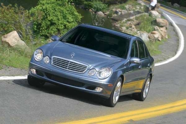 A file photo of a 2003 Mercedes-Benz E-500. Federal regulators are investigating reports of fuel leaks in about 250,000 E-Class cars from model years 2003 to 2008.