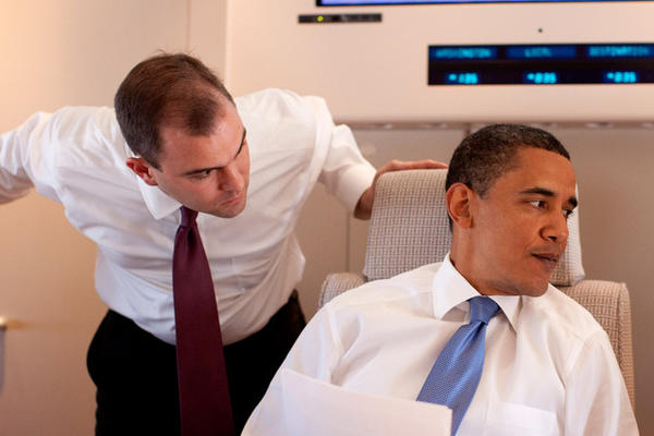 President Obama confers with speechwriter Ben Rhodes, left, on Air Force One en route to Cairo, Egypt in 2009.