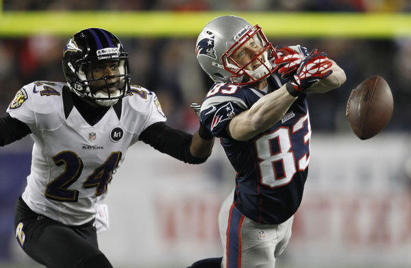 New England Patriots wide receiver Wes Welker (R) misses a pass while being covered by Baltimore Ravens cornerback Corey Graham during the first quarter in the NFL AFC Championship football game in Foxborough, Massachusetts, January 20, 2013.