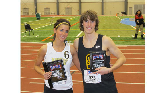 Jamie and Michael Topp pose with their awards from the NAIA National Indoor Track Championships which wrapped up on March 1. Both ran in the 3,200-meter relay with Jamie¿s team taking fifth and Michael¿s coming in eighth.