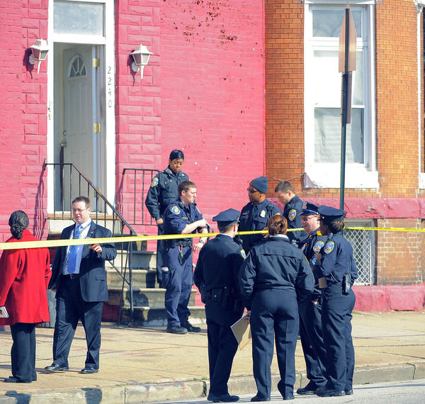 Police investigate a triple shooting in the 2200 block of N. Fulton Avenue in West Baltimore. The victims were two women and a man.