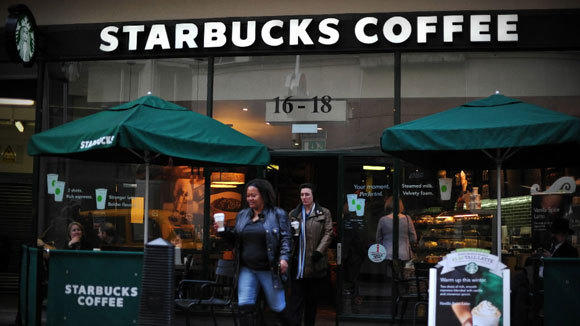 Customers exit a Starbucks store in London last month.