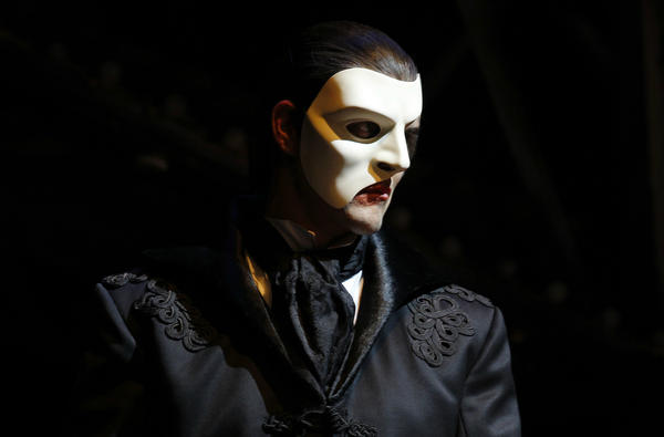"Ben Lewis portrays Phantom in a scene from Andrew Lloyd Webber's ""Love Never Dies."""