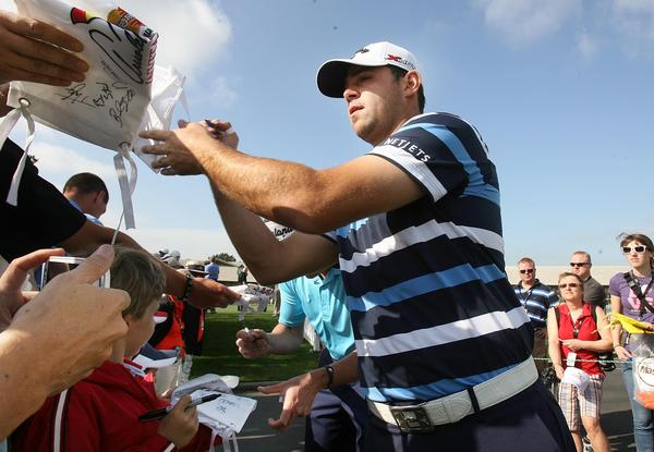 Gary Woodland signs autographs during practice rounds for the Arnold Palmer Invitational at the Bay Hill Club & Lodge in Orlando on Tuesday, March 19, 2013. (Stephen M. Dowell/Orlando Sentinel)