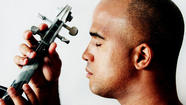 Violinist Daniel Bernard Roumain Performs at Woolsey Hall in New Haven on March 21