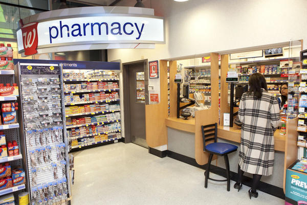 Walgreen Co. buys a stake in major drug wholesaler AmerisourceBergen, giving the pharmacy chain more muscle in setting prices.