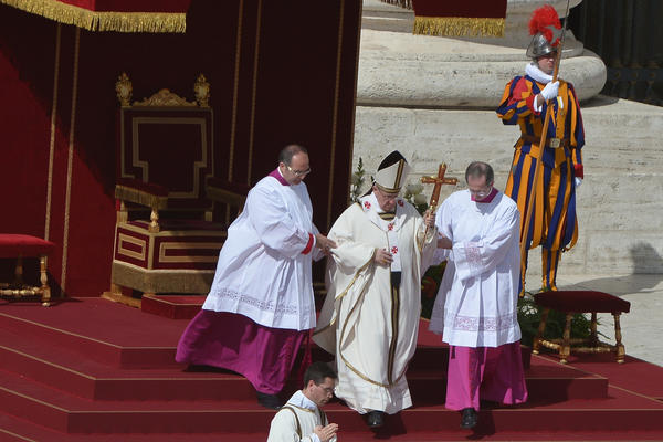 Pope Francis, center, walks to the altar during his grandiose inauguration mass at St Peter's square at the Vatican.