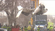 PHOTOS: Moving plane from crash site