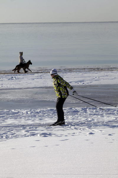 People enjoy winter activities by the seaside in Saulkrasti, Latvia.